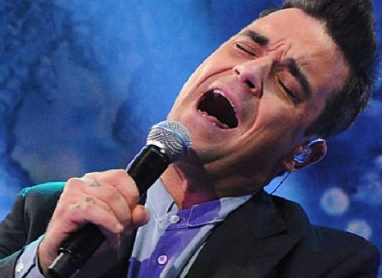 Robbie Williams gets festive with album and London party